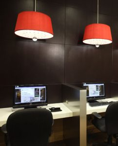 Two work desks with computers and overhead lighting at our Hanover Maryland hotel