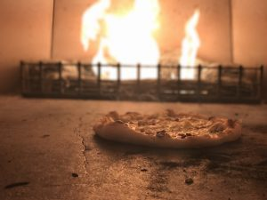 Pizza being made in the brick fire oven in the Vivo Italian restaurant at the Hotel At Arundel Preserve
