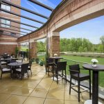 A large deck with tables and chairs at the Hotel at the Arundel Preserve located near the Arundel Mills Mall