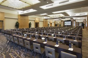 A luxurious and spacious conference room featuring a projector and more at the Hotel at Arundel in Hanover, MD