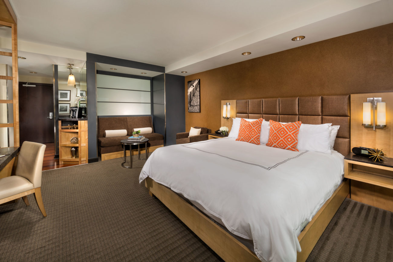 A king bedroom featuring a comfortable bed, work desk & more at the Hotel at Arundel Near BWI Airport